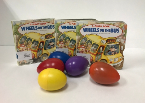 "Copies of ""Wheels on the Bus"" book with 5 shaker eggs"